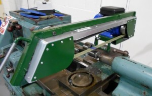Lathe mounted crankshaft polishing machine